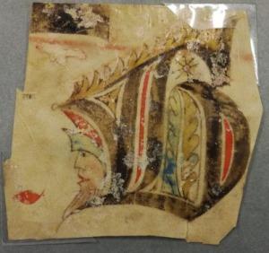 Lettrine découpée, ornée d'un visage, provenant d'un antiphonaire (manuscrit sur vélin non daté)